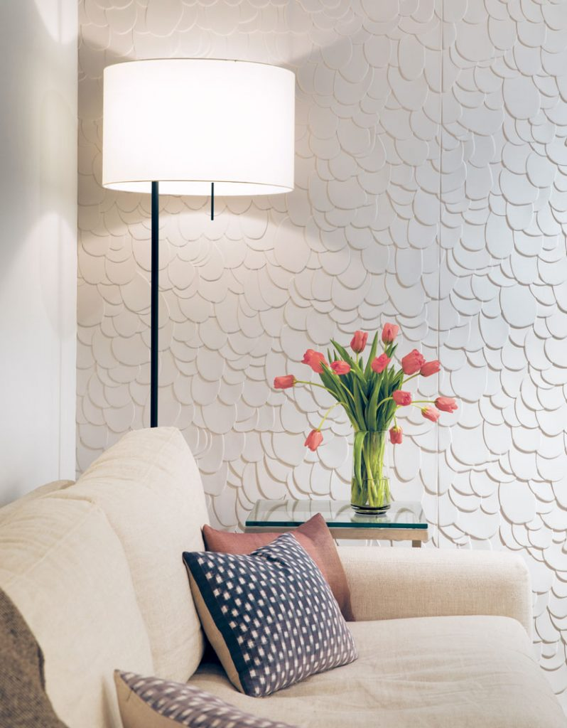After removing most of the maple shelves from the windowless media/multi-purpose room, Gillespie added a wallcovering with a cascading petal texture to add interest and warmth to the small space.