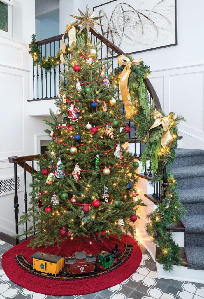 The old-fashioned tree in the new back entry is bedecked with classic Christopher Radko ornaments and includes a toy train—both part of the family's tradition.
