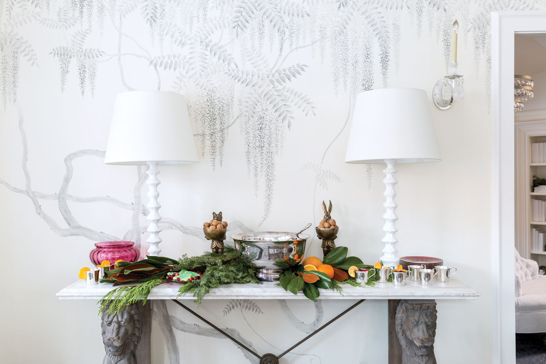 Hand-painted silk de Gournay wallpaper in a wisteria pattern honors Martha's southern roots. Her mother's punch bowl is center stage of the festivities.