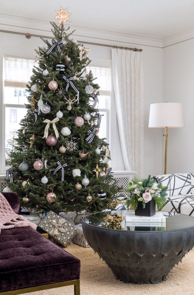 "The Christmas tree and wrapped gifts beneath are always ""in theme."" This year, it's black, white, blush, and gold."