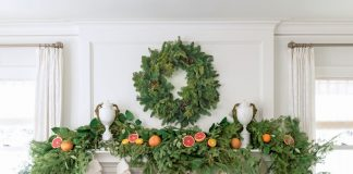 Fresh evergreens, citrus, and faux fur stockings decorate the period fireplace, capturing the spirit of the season and the expert blend of old and new in the stately 1920s Georgian.