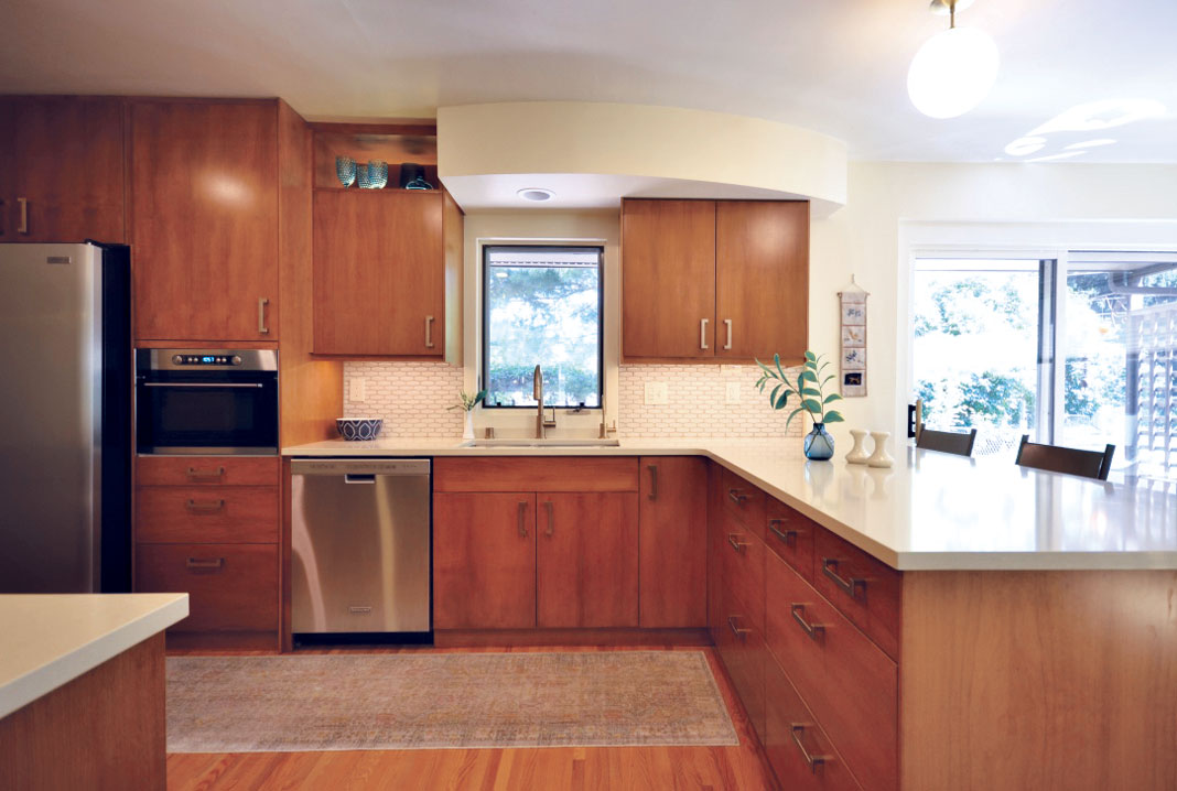 In this kitchen, the cream tones, combined with the warmth and texture of the natural wood, brought together an airy, light space with the mod mid-century look the client hoped for.
