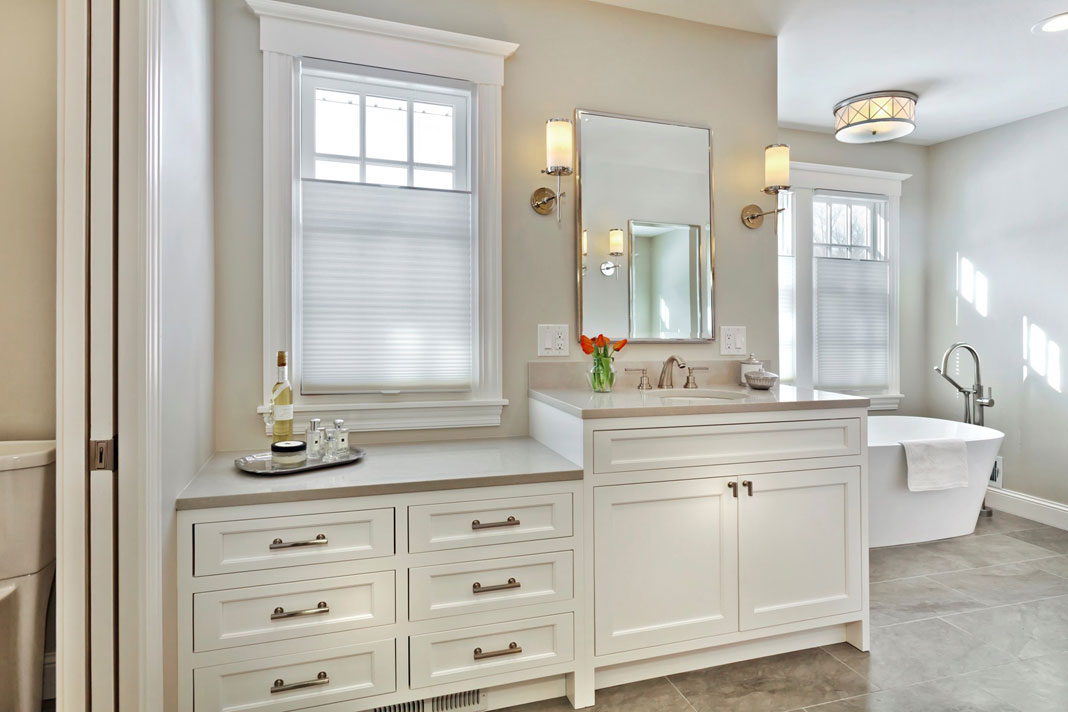 A large bathroom featuring a walk-in shower, free-standing tub, and his-and-hers closets.