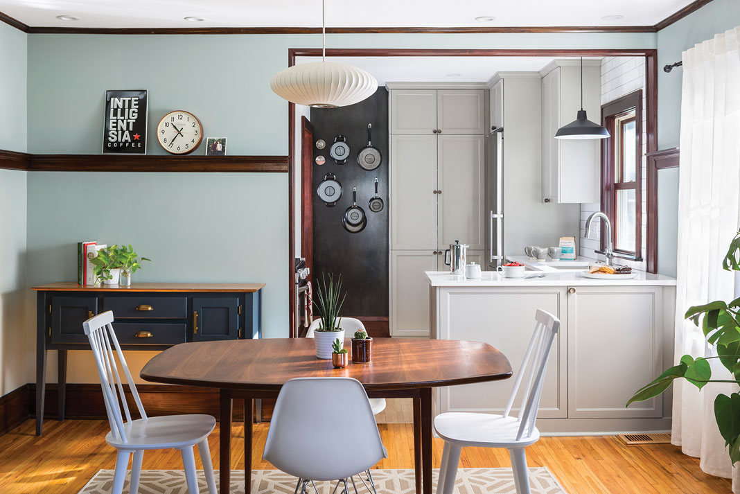 A kitchen featuring floating shelves, magnetic steel panel to hang pans and other cookware, and raised cabinets.