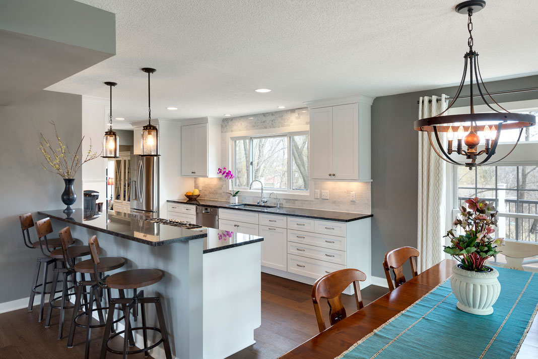 A small kitchen featuring loads of natural light and ample prep space for cooking and baking.