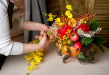 Floral putting together a fall inspired arrangement