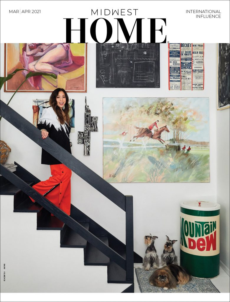 A woman walks down the steps on the cover of the March/April issue of Midwest Home