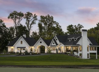 Large white farm house built by Lecy Bros Homes & Remodeling