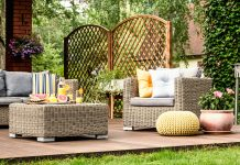 A yellow pouf brings color and character to this patio.