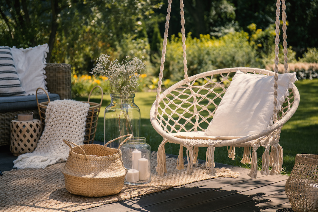 A hanging chair brings playfulness to your patio.