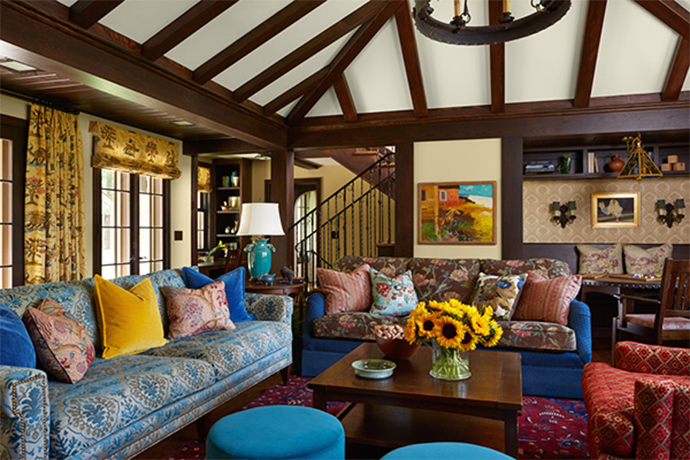 Image of colorful living room with blue, yellow, and pink pillows