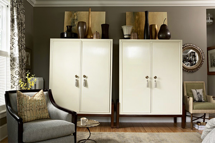 Image of two white cabinets with gold and dark brown accents