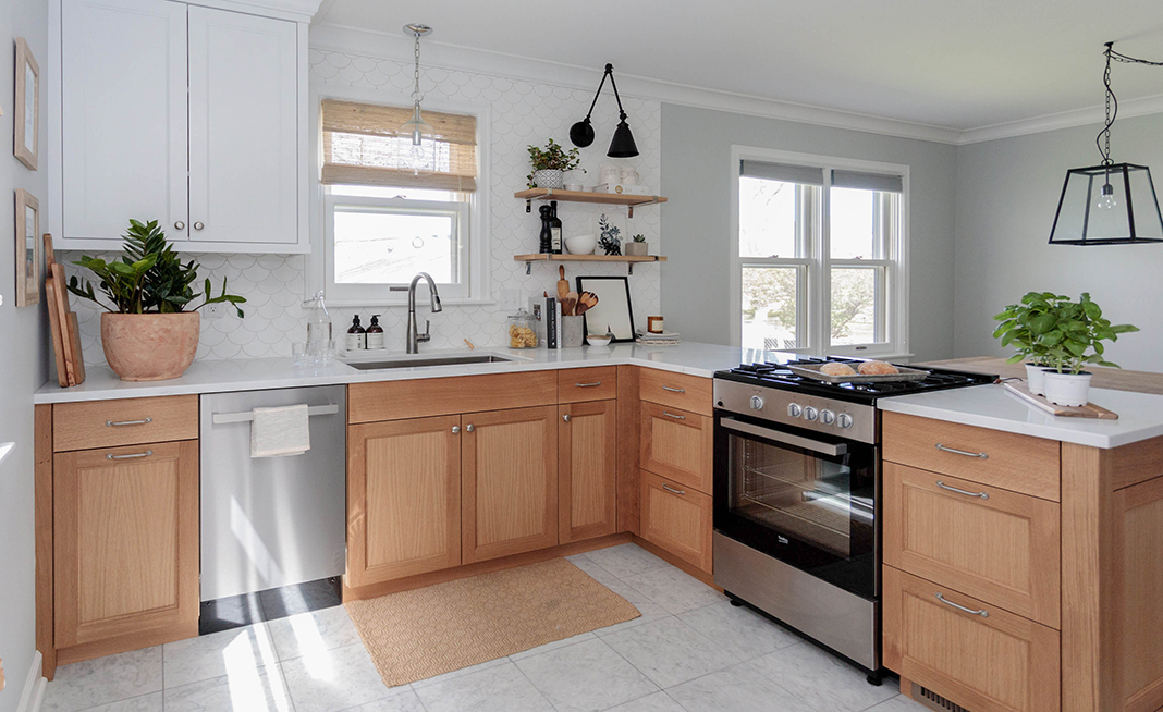 Image of a white kitchen with light wood
