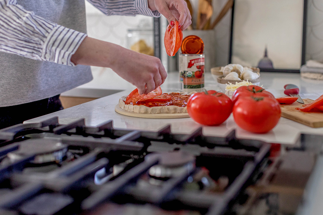 Image of woman slicing tomatoes