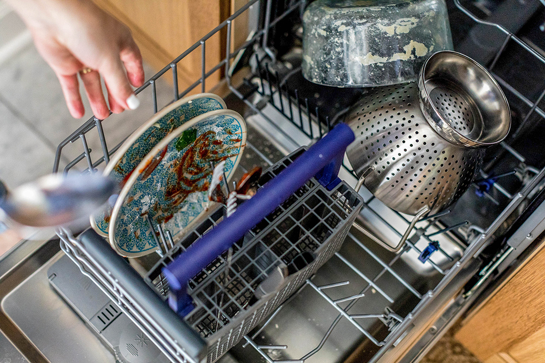 Image of dishwasher with dirty dishes