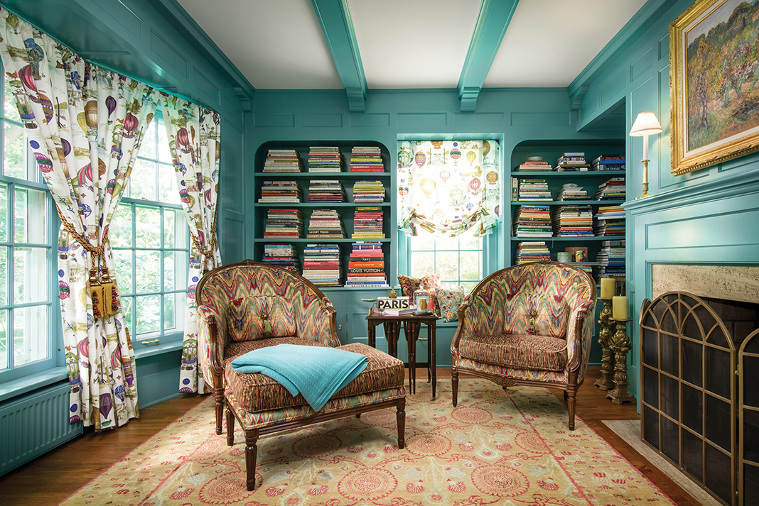 A bright, aqua study with patterned chairs.
