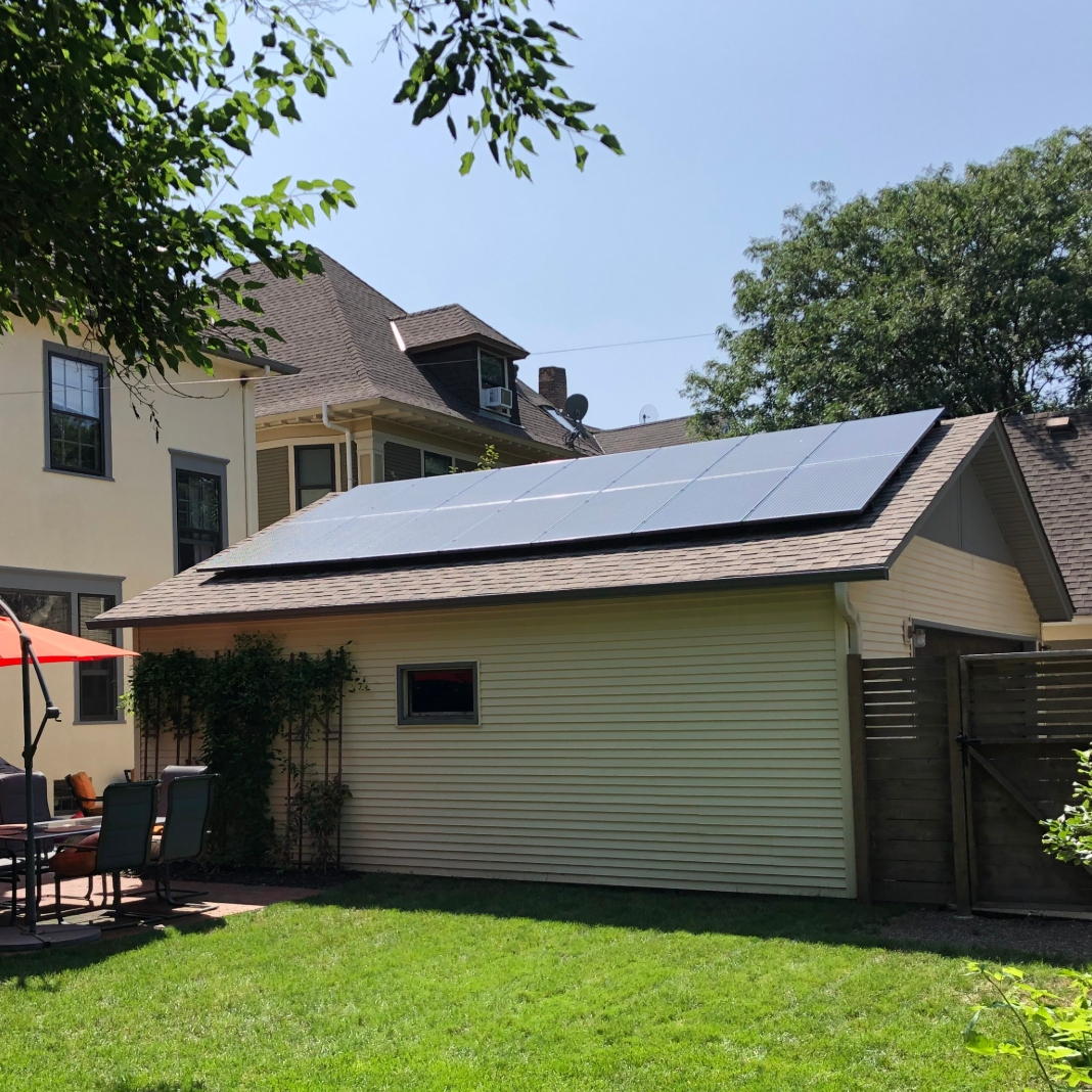 A garage with solar panels on the roof