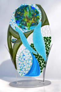 A blue, green, and clear tabletop sculpture