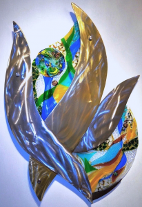 A blue, green, yellow, red, glass and metal wall sculpture