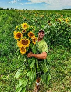 Dean Engelmann and some of the Tangletown farm's sunflowers