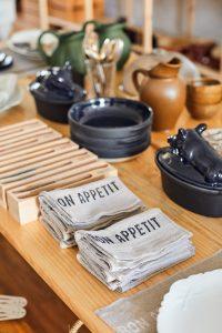 Smaller items like tea towels and ceramics at Flotsam + Fork
