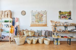 Flotsam and Fork Map Wall with wicker baskets below.