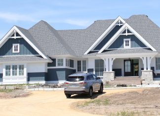 The gables and columns give just a hint of the traditional molding and details of this new build.