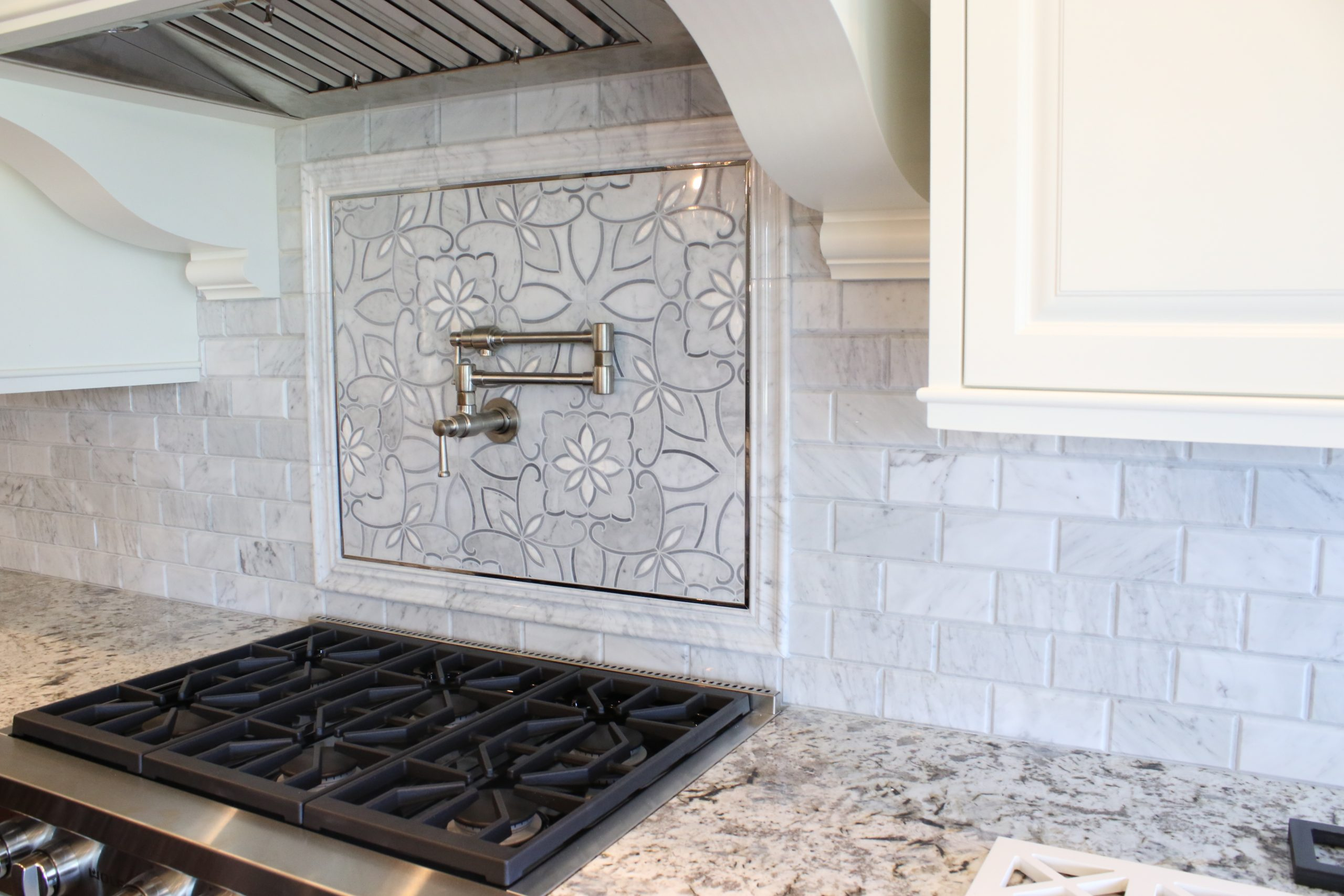 A more traditional aesthetic means more traditional wood molding of course, but that doesn't mean it can't have some softer tones, such as the flower backsplash above the stove.