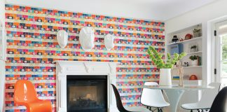 A bright and bold book-covered wallpaper steals the spotlight in the playroom.