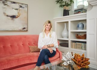 """Renae Keller perches on her newly reupholstered sofa, the first """"big girl"""" purchase she ever made and a piece she's kept for nearly 20 years."""