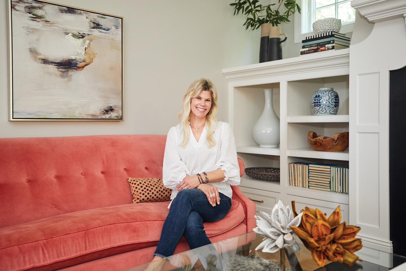 "Renae Keller perches on her newly reupholstered sofa, the first ""big girl"" purchase she ever made and a piece she's kept for nearly 20 years."