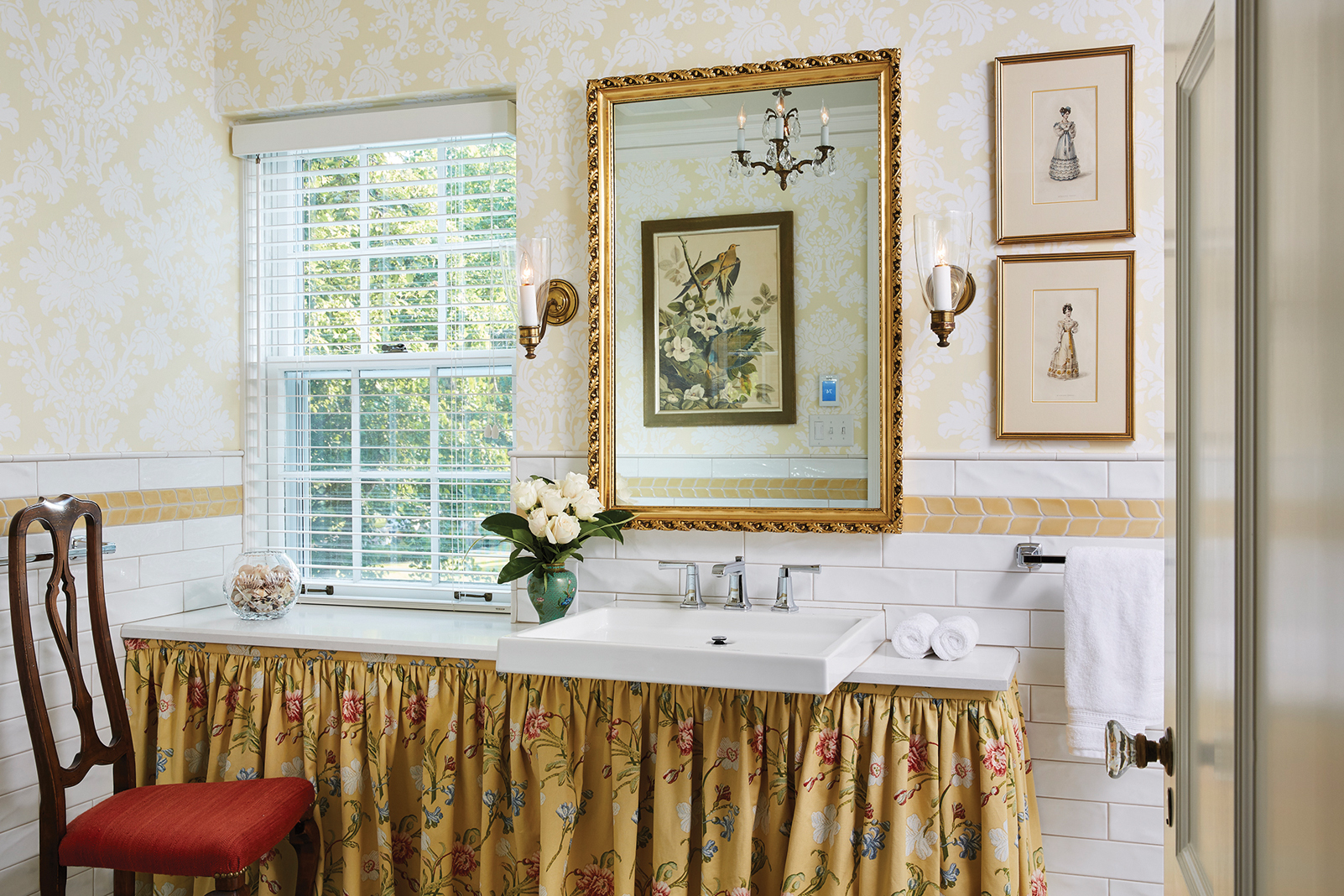 In the second-floor bathroom, Nature is further celebrated with floral patterns and audubon prints.