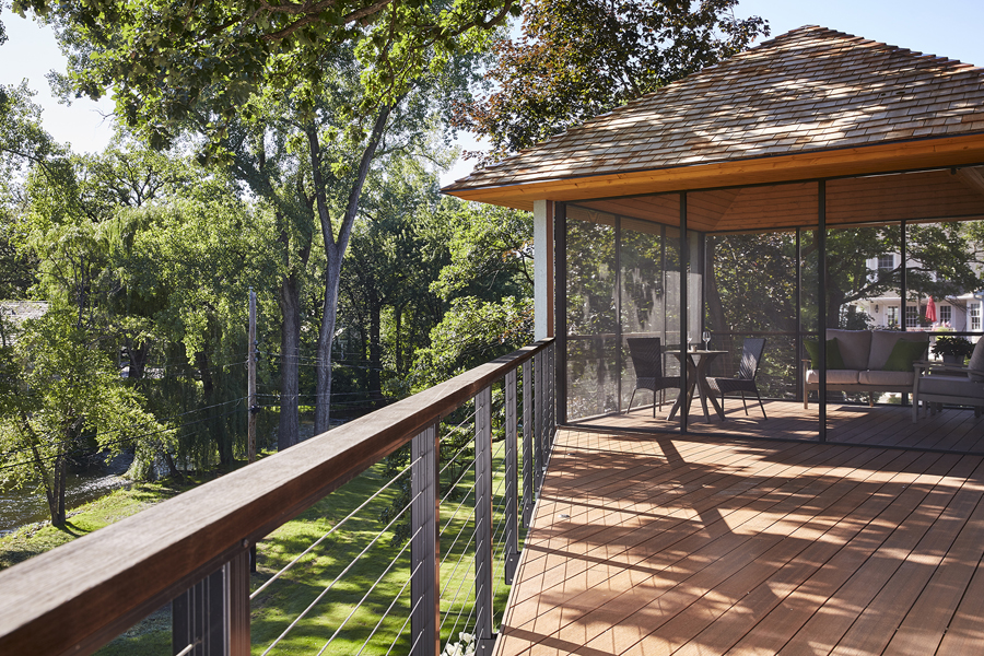 Christopher Strom's design is open and airy for this couple's creekside screen porch.