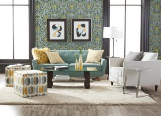 A lifestyle shot with a Lucy sofa, pillows, and ottoman. Photo courtesy Ethan Allen.