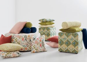 Pillows and ottomans from Ethan Allen's mid-century collection, Lucy. Courtesy Ethan Allen.