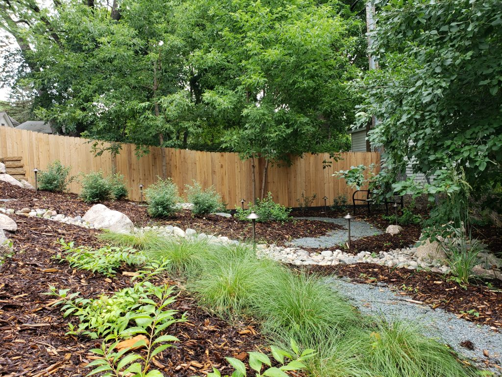 A backyard landscaped by Trio Landscaping