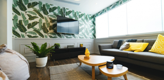 A living room with an accent wall