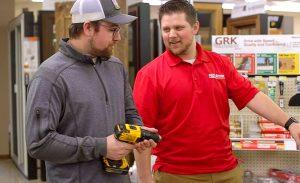 A store associate helping a customer